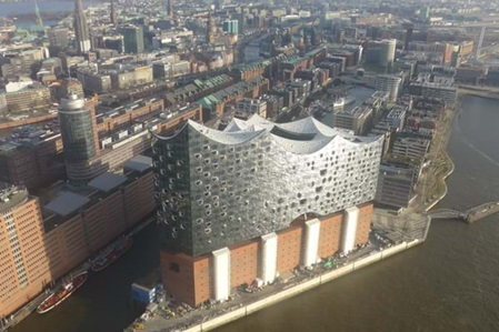 Birds view of Elbphilharmonie. The round aluminium plates are anodized and powder coated.